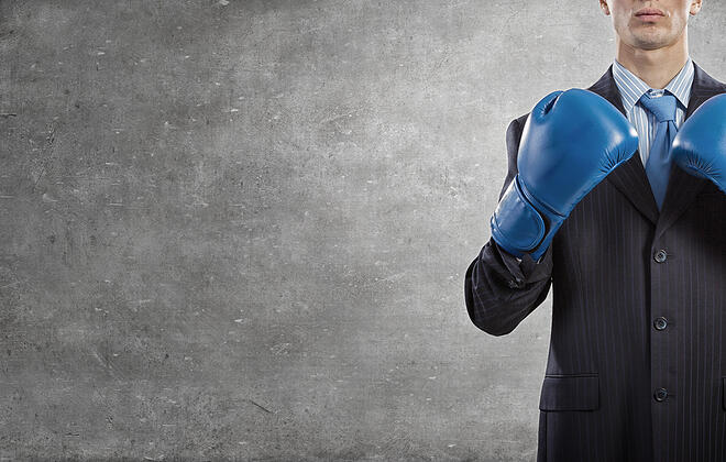 Social Post-Determined businessman in suit and boxing gloves